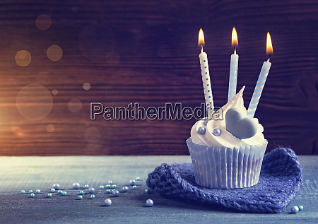 cupcake with a blue candles