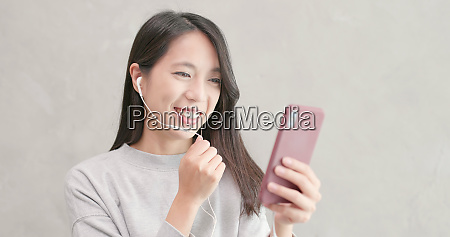 woman talk to smart phone with