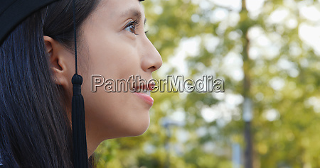 side profile of woman with graduation