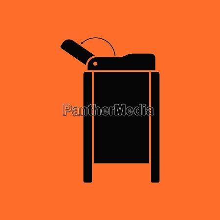 baby swaddle table icon orange background