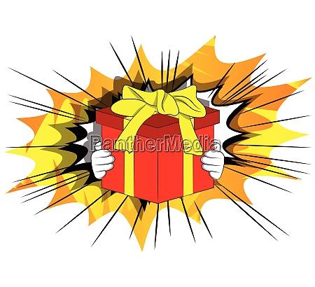 cartoon hand holding big gift box