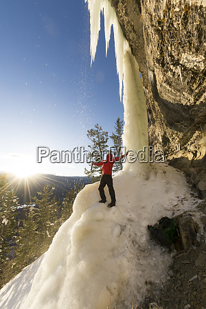 single male adventurous ice climber at
