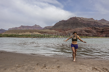 young woman emerges from cold water