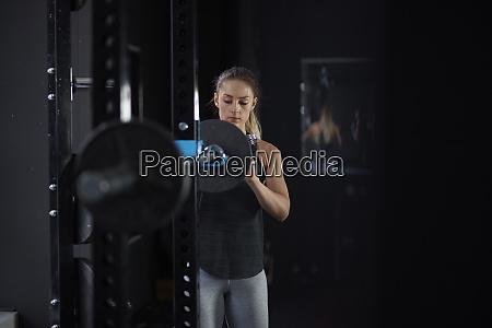 young blonde woman in sportswear in