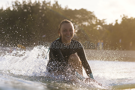young woman smiling at camera while