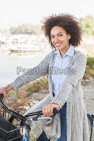 relaxed afro woman with bicycle