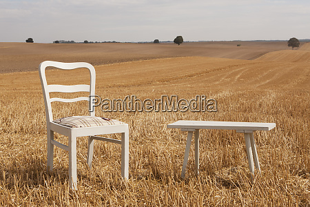 chair and bench in sunny rural