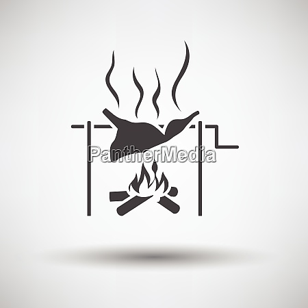 roasting meat on fire icon on