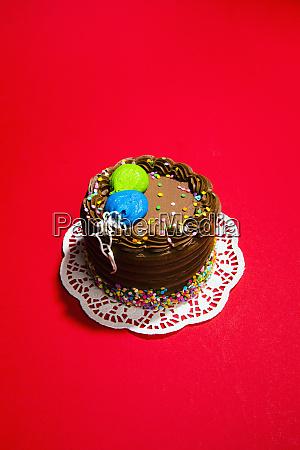 still life chocolate birthday cake on