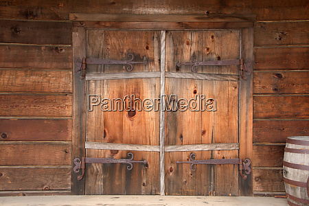 old wooden double doors with rusty