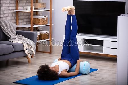 woman doing leg up exercise
