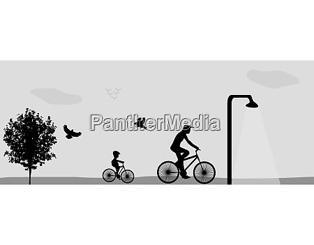 family riding bikes in the park
