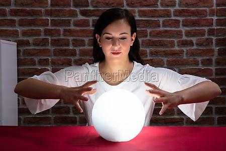 woman predicting future with crystal ball