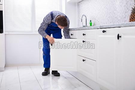 repairman fixing door