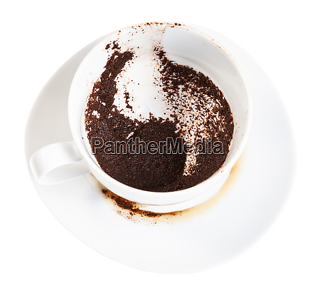 white cup with coffee sediments on
