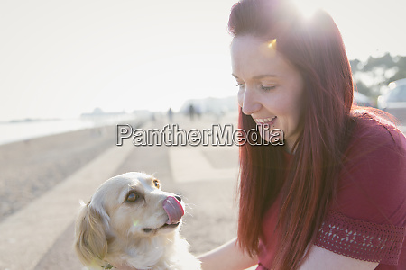 woman with cute dog on sunny