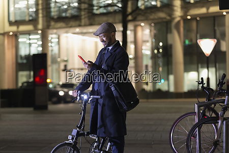 businessman with smart phone and bicycle
