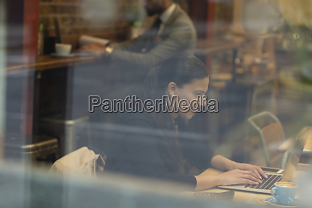smiling businesswoman working at laptop in