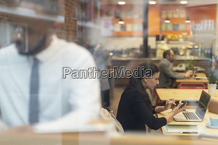 focused businesswoman working at laptop in