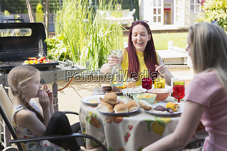 lesbian couple and daughter enjoying lunch