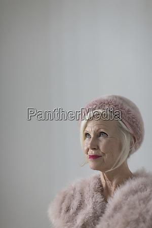 portrait confident elegant senior woman wearing