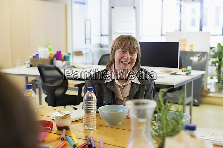 portrait smiling confident businesswoman eating in