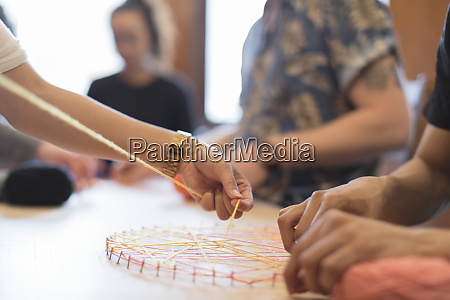 people doing string art project