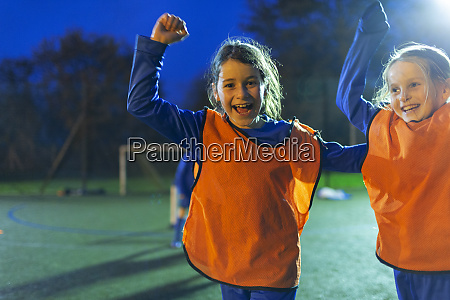 portrait enthusiastic girl soccer players cheering