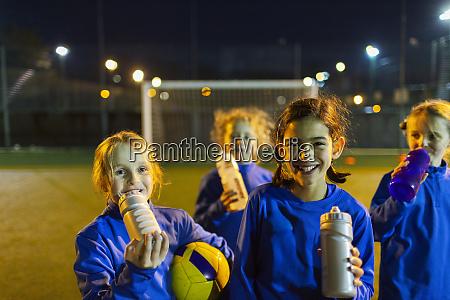 portrait smiling girls soccer team taking