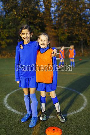 portrait smiling confident girl soccer players
