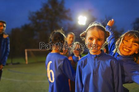 portrait confident happy girl soccer players