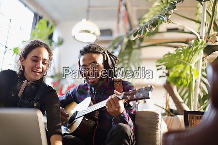 young man and woman recording music