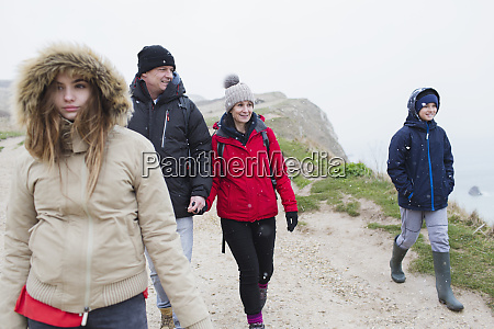 family in warm clothing walking on