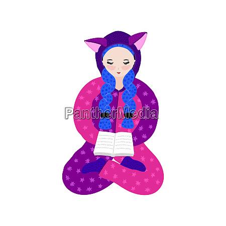 girl in kigurumi pajama reading book