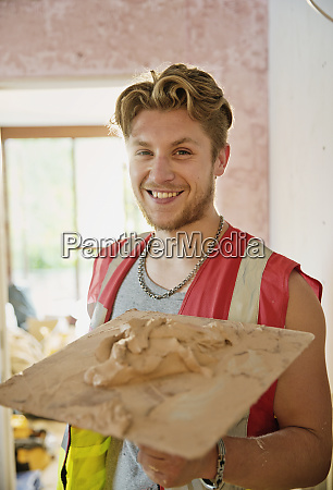 portrait smiling confident young construction worker