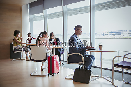 business people working in airport business