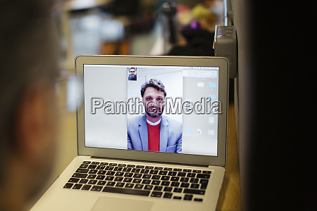 businessmen video conferencing on laptop