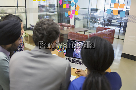 business people video conferencing at laptop