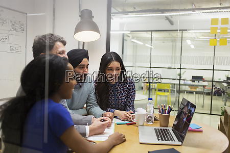 creative business people video conferencing at