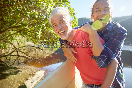 portrait playful father and son at