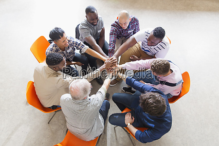 men joining hands in circle in