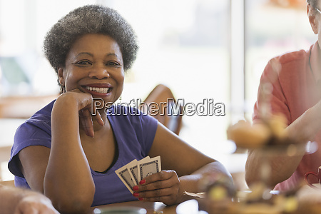 portrait smiling confident senior woman playing