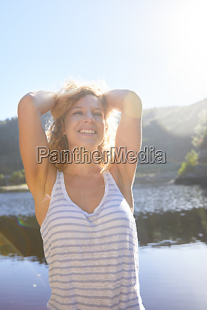 portrait confident carefree woman at sunny