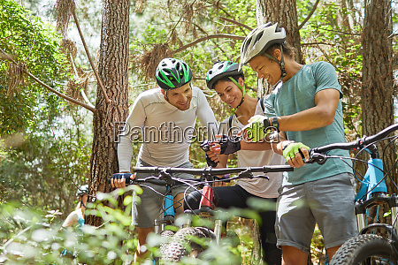 friends mountain biking using wearable camera