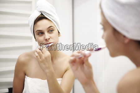 mirror image of young woman in