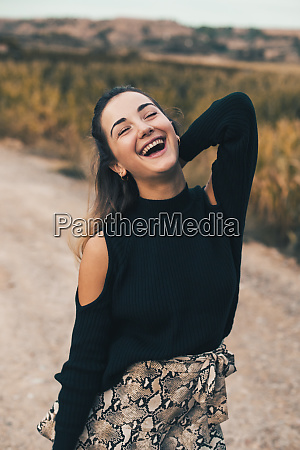 portrait of laughing young woman in