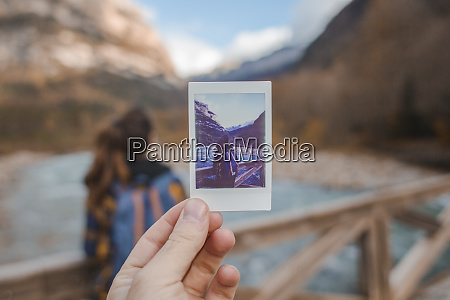 spain hand holding instant photo of