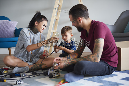 happy modern family decorating the home