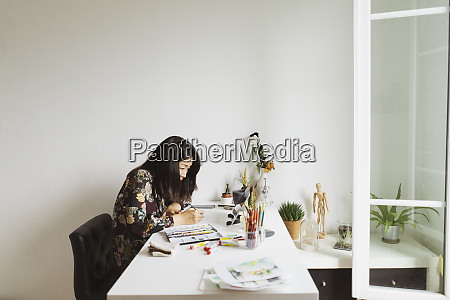 illustrator at work desk in an