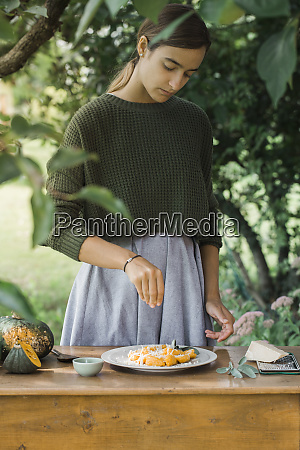 young woman with homemade pumpkin gnocchi